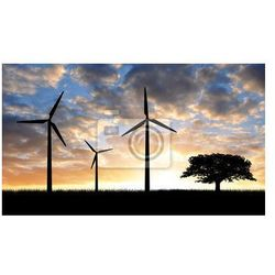 Obraz Turbiny wiatrowe z drzewa w zachodzie słońca