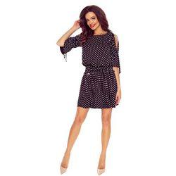 b7c469b646 Sukienka w groszki z rękawami 3 4 urozmaiconymi rozcięciami i zakończonymi  rozkloszowaniem dół luźny
